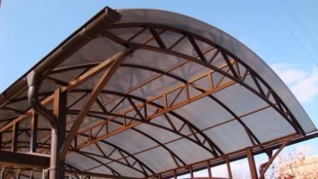 Фото арочного навеса из стальных труб